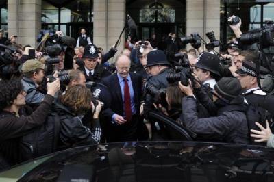 more QUESTIONS: George Entwistle speaks to reporters after giving evidence to the Commons select committee. Picture: EPA