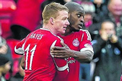 Jonny Hayes, left, after scoring the second goal for Aberdeen Photograph: SNS