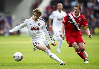 Hearts' Arvydas Novikovas is kept in check by Richard Brittain, of Ross COunty. Picture: SNS