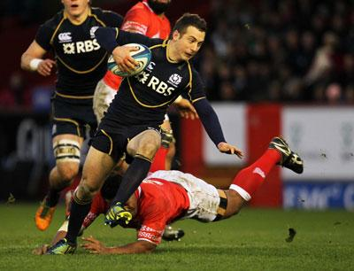 Greig Laidlaw and Tonga's Taniela Moa in action