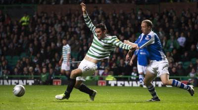 Celtic's Tony Watt is brought down by St Johnstone's Steven Anderson for a penalty on Tuesday night. Picture: SNS