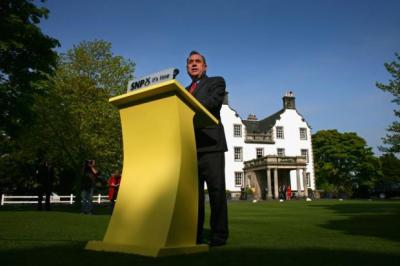 ALONE: Alex Salmond addresses the press after the SNP's election victory in May 2007, above, at the outset of a premiership whose sunny start has at times been overcast, left.