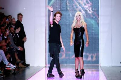Christopher Kane and Donatella Versace at Milan Fashion Week 2012. Photograph: Vittorio Zunino Celotto/Getty Images