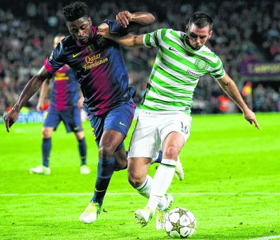 Joe Ledley halts the progress of Alex Song. Picture: SNS