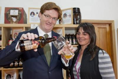 I'LL DRINK TO THAT: Chief Secretary to the Treasury Danny Alexander with Cairngorm's Samantha Faircliff.