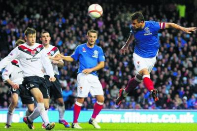 Lee McCulloch heads Rangers in front with his 17th goal of the campaign