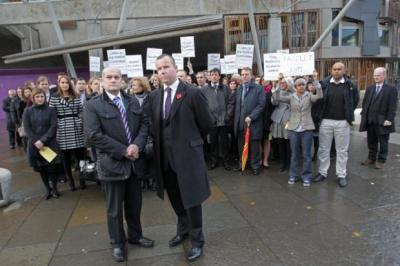 united front: Austin Lafferty, left, and Cameron Tait, with fellow lawyers at yesterday's protest outside Holyrood. Picture: Stewart Attwood