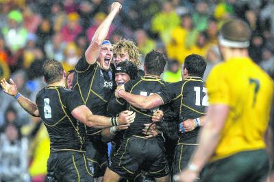Al Kellock and his team-mates celebrate defeating Australia in the summer. Picture: Getty Images
