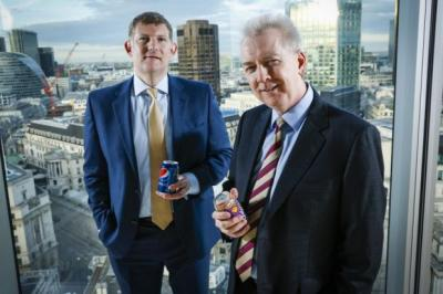 IN THE CAN: Roger White, chief executive of AG Barr, left, and John Gibney, finance director of Britvic have sealed the deal. Picture: Chris Winter
