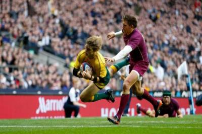 Nick Cummins is too quick for Toby Flood as he runs in Australia's try   Photograph: Getty