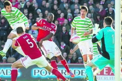 Celtic striker Tony Watt rises above the Aberdeen defence to power a header towards goal