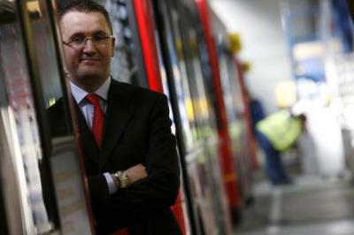 FAST LANE: Alexander Dennis's chief executive Colin Robertson, 2011 Entrepreneur of the Year, above. From left, Tom Cross, Stuart McLean and Jim Walker will contest this year's award. Main picture: Steve Cox