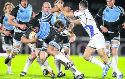 Ofa Fainga'anuku tries to hold off Leinster's Brendan Macken and Andrew Goodman.  Picture: Graham Stuart