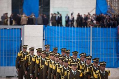 duty: Members of an honour guard leave the mausoleum of Yasser Arafat after a ceremony on the day the ex-leader was exhumed. Picture: Getty
