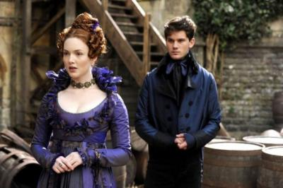 lacking DISTINCTION: Jeremy Irvine as Pip and Holliday Grainger as Estella in Mike Newell's Great Expectations, which looks fantastic but can't escape comparison with the recent BBC adaptation.