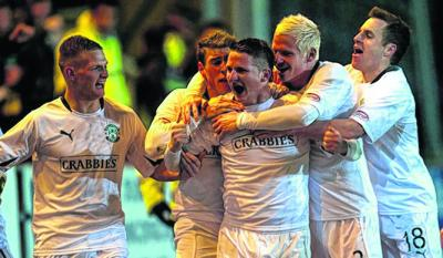 Paul Cairney, centre, is mobbed after scoring the winner