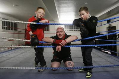 FOCUS: Dylan and Martin, both aged 13, with owner Bernie Hammersley in the gym in Broomhill, Glasgow. Picture: Colin Mearns