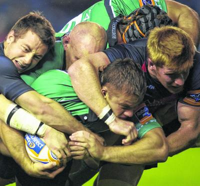 Greig Laidlaw and Roddy Grant battle  against Connacht last season. Picture: SNS