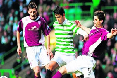 Celtic's Miku is closely shepherded by the attentions of Arbroath midfielders Paul Currie, left, and Stuart Malcolm    Photograph: SNS