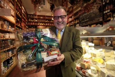 ALL SMILES: Chief executive Philip Contini with one of this year's Christmas hampers. Picture: Steve Cox