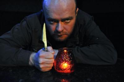 CUTTING EDGE: Daibhidh Walker's leather-clad Macbeth enjoys a drink or two. Picture: Ian Watson