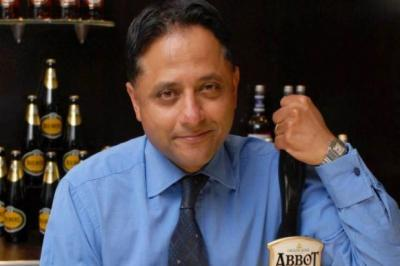 TOAST: Chief executive Rooney Anand was delighted with the results in Scotland. Picture: VisMedia