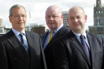 UPBEAT: Brewin Dolphin executive chairman Jamie Matheson, flanked by divisional director Alasdair Ronald and assistant director David Moore.