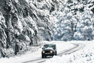 WINTER'S GRIP: The B974 in Aberdeenshire was closed after heavy snow yesterday. Picture: Derek Ironside