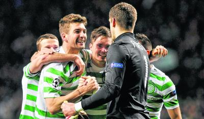 Goalkeeper Fraser Forster celebrates victory with his  team-mates. Picture: Nick Ponty