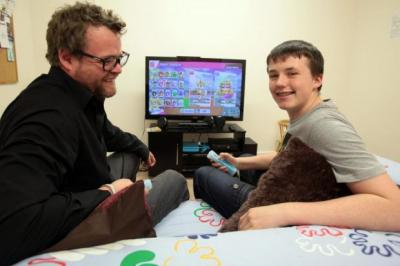 support: Befriending co-ordinator Jon Anderson with 14-year-old Connor Denholm at the Lomond Crescent Centre, Stirling. Picture: Steve Cox