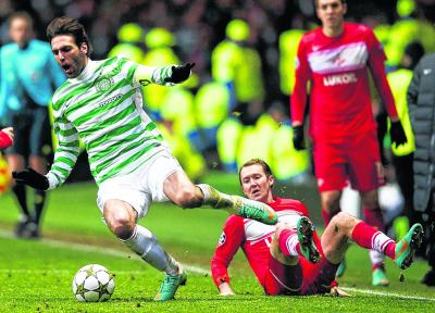 Georgios Samaras takes a tumble after being fouled  by Aiden McGeady