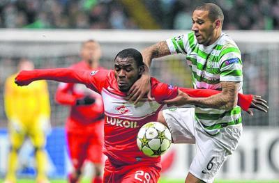 Kelvin Wilson battles with Emmanuel Emenike of Spartak Moscow