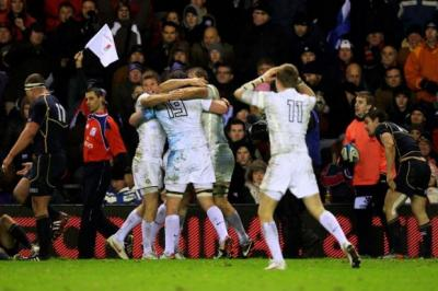 England players celebrate victory at Murrayfield   Photograph: Getty