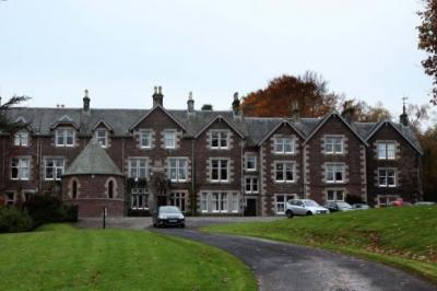 SHOCK: The 14-bedroom Cromlix House, above, was the venue for the wedding of Jamie Murray, far right, to Alejandra Gutierrez, in 2010, an event attended by Andy Murray, far left, and Kim Sears. Picture: Gordon Terris