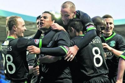 The Hibernian players mob Tom Soares after his second goal of the day gives them a 3-0 lead    Photograph: Bill Murray/SNS