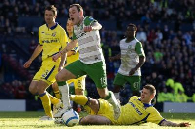 Anthony Stokes falls under the challenge of Michael Nelson.  Picture: SNS