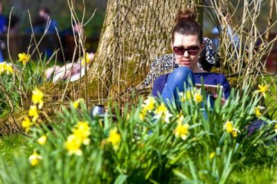 joy: Marta Szczesny, above, joins the crowds enjoying the sun at the Botanic Gardens in Glasgow yesterday, right, while Genevieve Nutt, 4, tries an ice cream at Irvine beach, Ayrshire. Pictures: Phil Rider and Colin Mearns