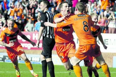 Jon Daly celebrates the first of a sparkling double strike for Dundee United against Dunfermline   Photograph: SNS
