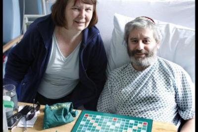 RECOVERING: Raymond Tate in hospital with his wife Julie.