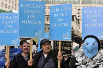 SIGN OF THE TIMES: Irate protesters at the bank's gathering.