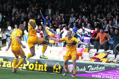 Nicky Law, right, celebrates putting Motherwell 2-0 ahead. Picture: PA