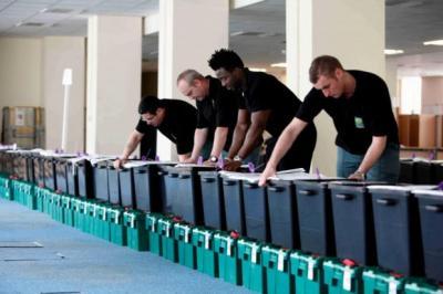 ELECTIONS: A COUNCIL WORKER CHECKS BALLOT BOXES