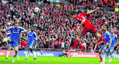 Andy Carroll scored for Liverpool and was adamant he had headed in another, but Roberto Di Matteo was the one celebrating at Wembley