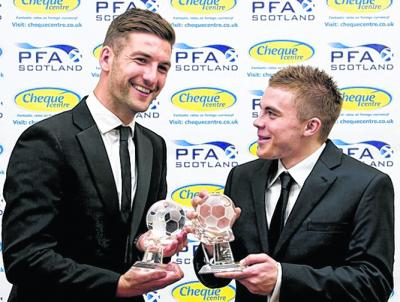 Celtic's Charlie Mulgrew, left, and James Forrest celebrate being named Player of the Year and Young Player of the Year respectively at last night's Cheque Centre PFA Scotland Player of the Year awards in Glasgow.  Ross County's Derek Adams won the manager of the year award.  Falkirk's Farid El Alagui, John Robertson of Cowdenbeath and Steven May of Alloa won the first, second and third division awards. Picture: SNS