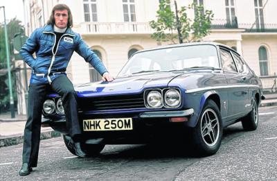 Sir Jackie Stewart alongside his Ford Capri back in the day . . .