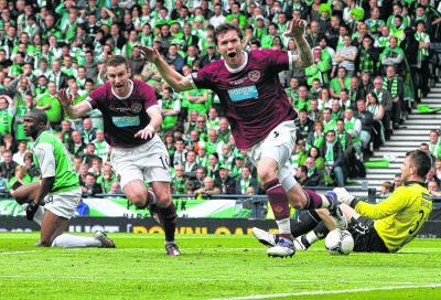 Darren Barr wheels away after opening the scoring for Hearts on Saturday. Picture: Stewart Attwood
