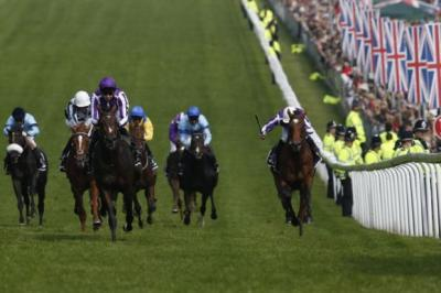 Joseph O'Brien and Camelot (second left) destroy their rivals at Epsom        Photograph: Reuters