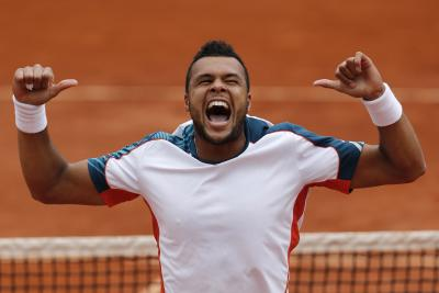 Tsonga celebrates beating Stanislav Wawrinka. Picture: Getty