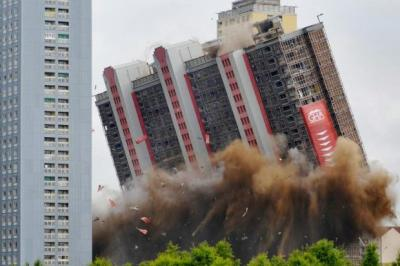 GOING, GOING, GONE: Crowds gathered to mark a moment of history as the Red Road flats, a dominant part of Glasgow's skyline for decades, were demolished in the space of just a few seconds. Pictures: Martin Shields