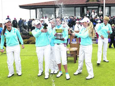 Champagne celebrations for the  GB & I Curtis Cup team. Picture: SNS